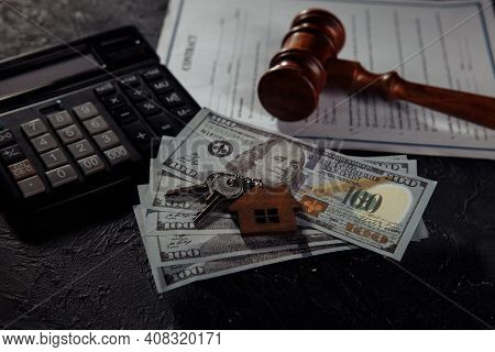 House Keys And Dollar Banknotes With Judge Gavel