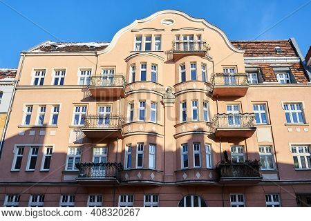 Facades With Balconies Of Historic Tenement Houses In The City Of Poznan