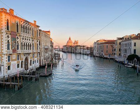 Venice, Italy, February 14, 2021 - View of the Grand Canal and Basilica Santa Maria della Salute from the Ponte dell'Accademia in Venice, Italy