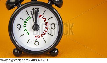 Time To Fasting Symbol. Beautiful Black Alarm Clock With Words 'eating Fasting'. Beautiful Orange Ba