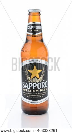 IRVINE, CA - JANUARY 12, 2015: A bottle of Sapporo Beer isolated on white. The Japanese brewery was founded in 1876 by German trained brewer Seibei Nakagawa. It is the oldest beer brand in Japan.