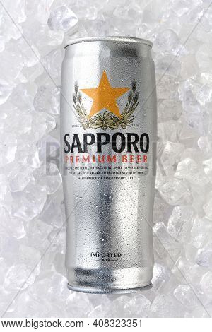 IRVINE, CA - JANUARY 12, 2015: A can of Sapporo Beer on a bed of Ice. The Japanese brewery was founded in 1876 by German trained brewer Seibei Nakagawa. It is the oldest beer brand in Japan.