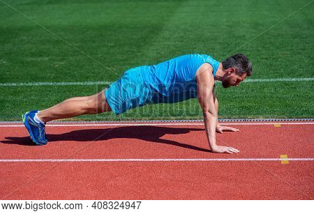 Male Strength And Power. Sportsman In Plank. Athlete Do Pushups. Train His Core Muscles. Man Doing P