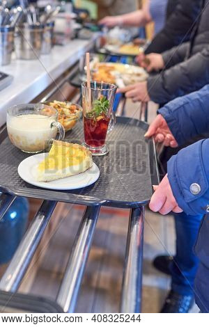 The Queue At The Checkout In The Gastronomic Cafe. Distribution Line In The Dining Room. Trays With
