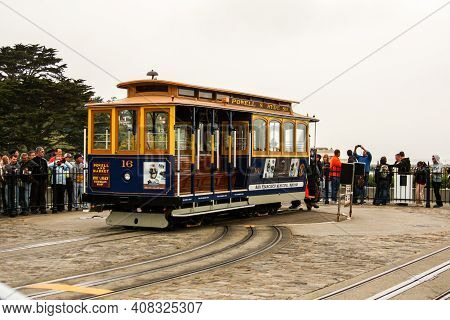 San Francisco, California / United States Of America - May 27th 2013: Nostalgic Yellow And Blue Cabl