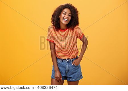 Portrait Of Charismatic Charming African American Stylish African American Female In Trendy Shorts A