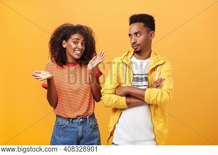 Guy Thinks His Friend Weirdo Making Dumb Thinks Looking At Cute Girl With Look Crossing Arms On Ches