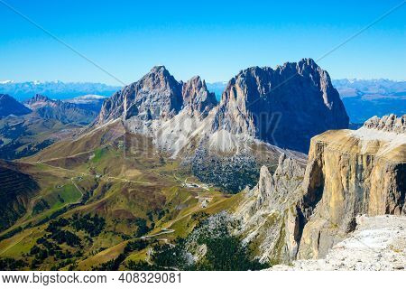 Pordoi is a mountain pass of the Dolomites, located between the Sella mountain range and the Marmolada mountain. The Passo-Pordoi pass. Warm sunny day in the Alps