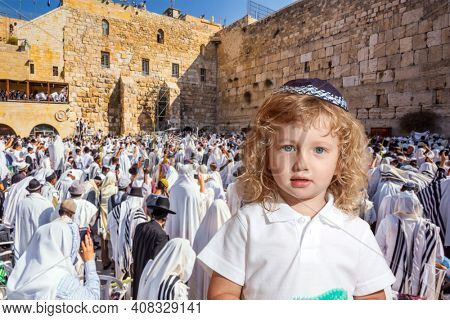 The blessing of the Cohenim. Passover. Jews praying at the Western Wall. Ceremony at the Temple Mount in Jerusalem. The concept of religious and photo t