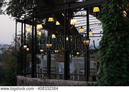 Spectacular Outdoor Dining Restaurant. Garden Terrace Restaurant With Beautiful Illumination In The