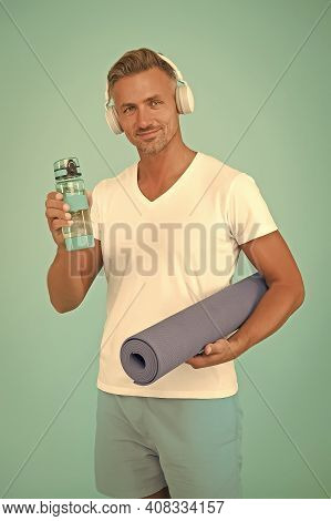 Stay Hydrated. Thirsty Sportsman Blue Background. Happy Athlete Hold Water Bottle And Gym Mat. Thirs