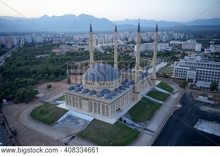 Muslim Mosque In Antalya, Turkey. Top View Of Blue Mosque Minaret And City Skyline With Mountains In
