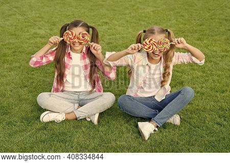 You Wont Believe Your Eyes. Sweet Look. Happy Kids With Candy Glasses. Beauty Look Of Little Girls.