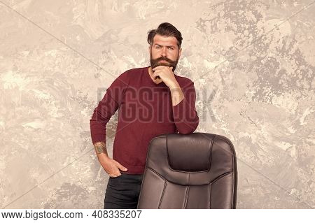 Beard Trend Is Not Over. Bearded Man Stand At Office Chair. Trendy Hipster Wear Casual Style. Mens F