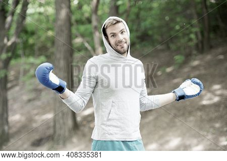 Sportsman Boxer Training With Boxing Gloves. Boxing Concept. Man Athlete On Happy Face With Sport Gl