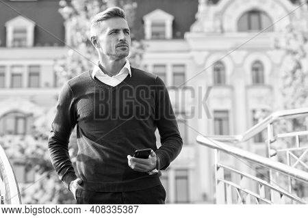 Confidence Is Everything. Confident Man With Phone On Urban Outdoor. Confident Look Of Modern Guy. C