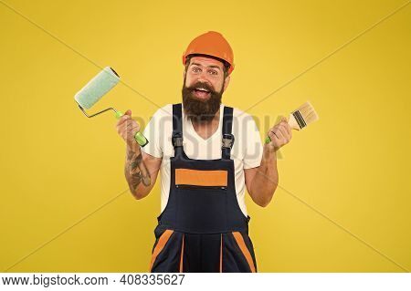Meet Natural Art. Decorator Hold Paint Roller And Brush. Happy Painter Yellow Background. Color Man