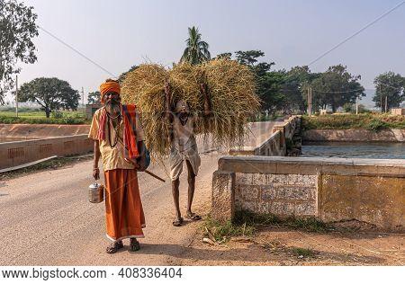 Bullapur, Karnataka, India - November 9, 2013: Wandering Sadhu With Saffron Colored Skirt, Turban, A
