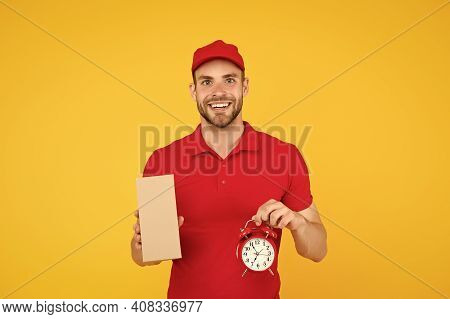 Delivery Time. Delivery Courier With Time Clock Holding Box. Take Your Parcel. Gift Delivery Man Hol