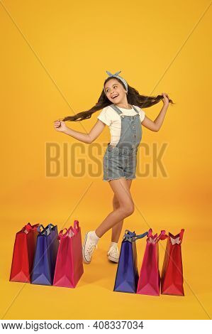 Cosmetics Shop. Little Girl With Shopping Packages. Happy Child In Shop With Bags. Small Child In Su