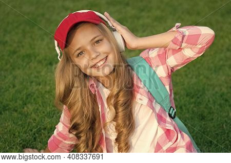 Pleasant Time. Child Headphones Listen Music. Girl Headphones Listening Music. Educational Podcast.