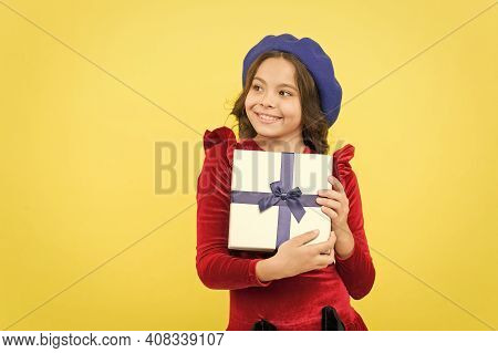 Positive Girl In Vintage Beret With Gift Box. Trendy Parisian Child Holding Present. Smiling Teenage
