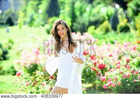 Spring Young Woman In Summer Fields Being Happy Outdoors. Woman Enjoy Outdoor Recreation. Natural Be