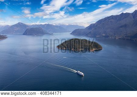 Aerial View Of A Ferry Boat Traveling In Howe Sound During A Sunny Summer Day. Taken North Of Vancou