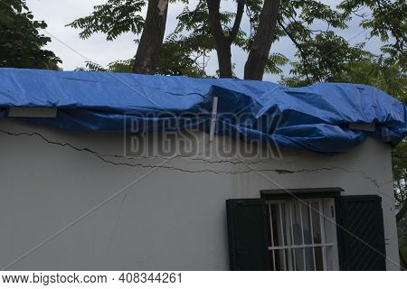 Storm Damage, Broken House Roof, Provisional Fixed With A Plane
