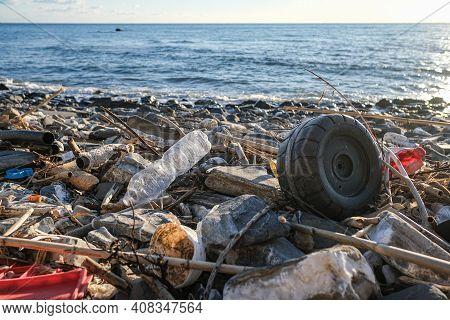 Discarded Plastic Trash Pollution On Contaminated Ocean Sea Coast Ecosystem, Environmental Waste