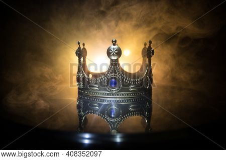 Low Key Image Of Beautiful Queen/king Crown Over Wooden Table. Vintage Filtered. Fantasy Medieval Pe