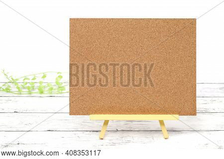 Wooden Easel And Blank Board On A White Wooden Table