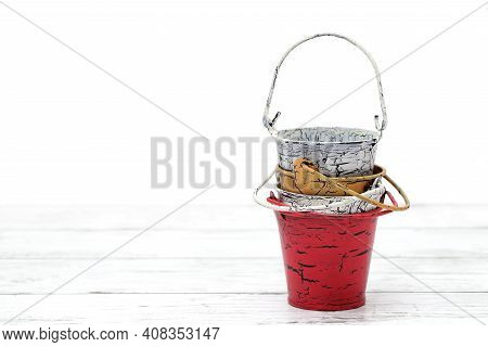 Empty Miniature Metal Bucket On White Wooden Table