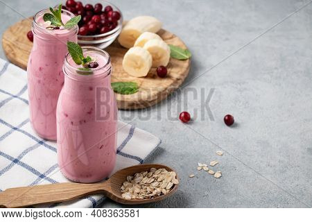 Homemade Yogurt Smoothie With Banana, Cranberry And Oatmeal, Copy Space