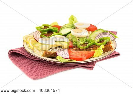 Sandwiches With Cheese, Sundried Tomatoes, Eggs, Pepper, Avocado And Seeds, Lettuce, Lemon On Beige