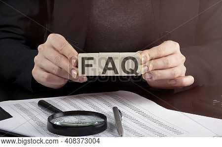 Businesswoman Holding Wooden Block With Text Faq, Business