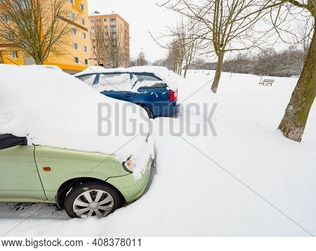 Parced Car Covered In Snow In Winter Season. Cars Under Big Snow Cover From Night Snow Storm