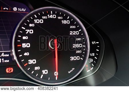 Electronic Dashboard Of Modern Luxury Car View From Aside. Speedometer Shows Speed In Kilometers Per