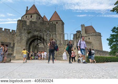 Carcassonne,france-august 15,2016:people Visit The Famous Fortified Medieval City Of Carcassone Duri