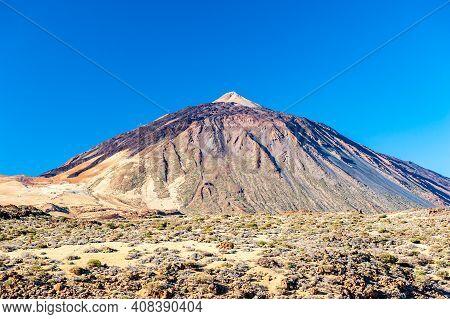 Silhouette Of Volcano Del Teide Against  Blue Sky. Pico Del Teide Mountain In El Teide National Park