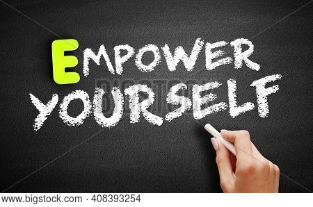 Hand Writing Empower Yourself On Blackboard, Concept Background