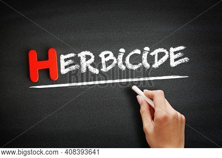 Hand Writing Herbicide On Blackboard, Concept Background