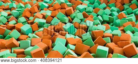 Background With Bright Red And Green Soft Blocks Or Cubes. Multicolored Geometric Background. Banner