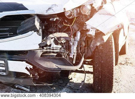 A White Car Crashed Accident. Car Accident On The Road. Car Crash Accident On Street. Damaged Vehicl