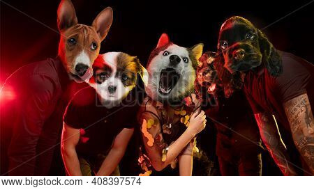 Rockstars Band. Talented Dogs, Professional Musicians Performing On Dark Background In Neon Light. C
