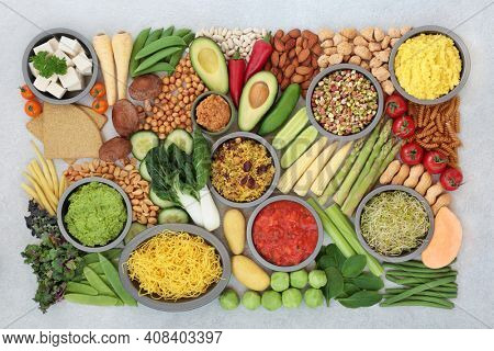 Vegan health food for a plant based diet with a large collection of food high in antioxidants, protein, minerals, fibre, anthocyanins, vitamins, lycopene, omega 3  smart carbs. Healthy eating concept.