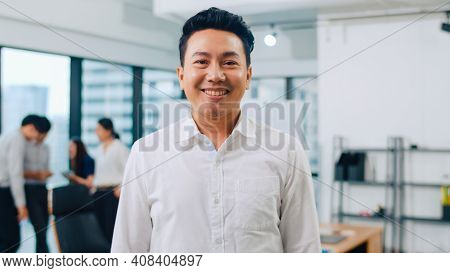Portrait Of Successful Handsome Executive Businessman Smart Casual Wear Looking At Camera And Smilin