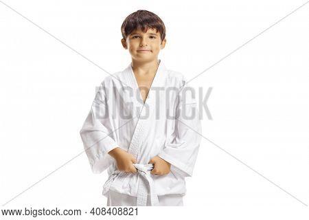 Child in karate kimono holding his belt isolated on white background