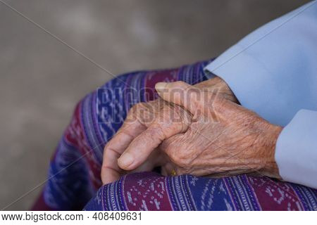 Close-up Of Hands Elderly Woman's Joined Together. Focus On Hands Wrinkled Skin. Space For Text. Con