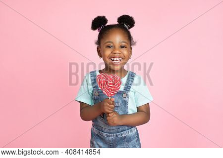 Happiness, Childhood, Kid And Sweets. Cute Pretty Little African Girl Child, Posing To Camera With C